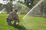 Daly City sprinkler repair technician finishes a job